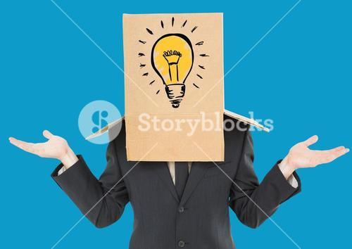 Businessman gesturing with a cardboard box on his head with light bulb