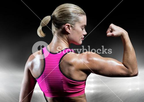 Fit woman flexing muscles