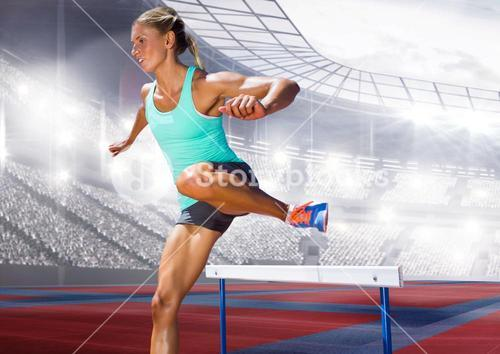 Digital composite image of female athlete jumping above the hurdle