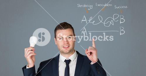 Businessman holding a electric bulb