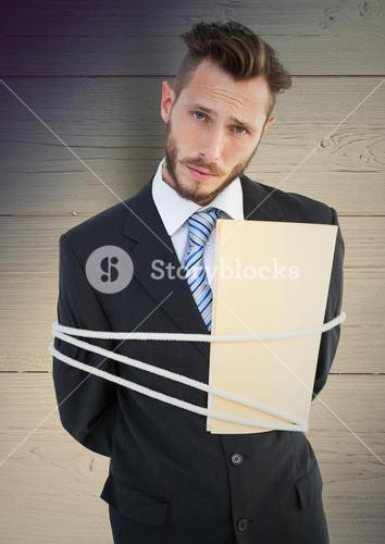 Digital composite image of a tied businessman
