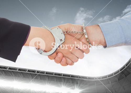 Digital composite image of business professional shaking hands with hand cuffs