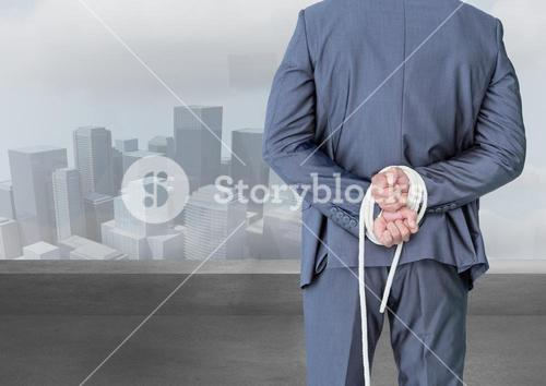 Digital composite image of a businessman with his hands tied behind the back