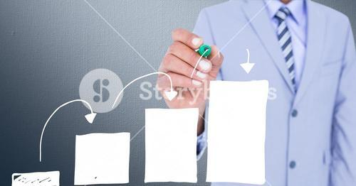 Digital composite image of businessman drawing a bar graph