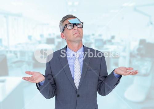 Businessman gesturing with sticky note stuck on his forehead