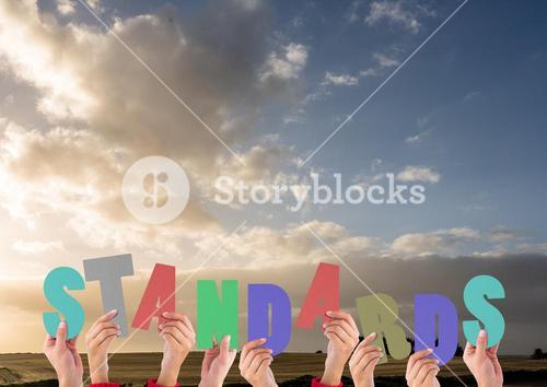 Digital composite image of hands holding standards cutouts