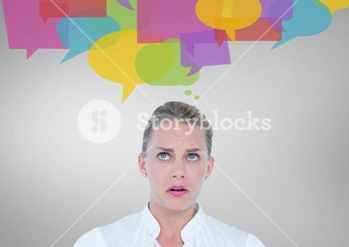Digital composite image of confused woman with speech bubbles