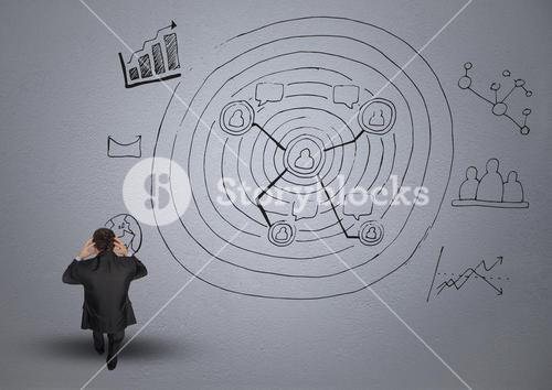 Digital composite image of frustrated businessman and business graphics