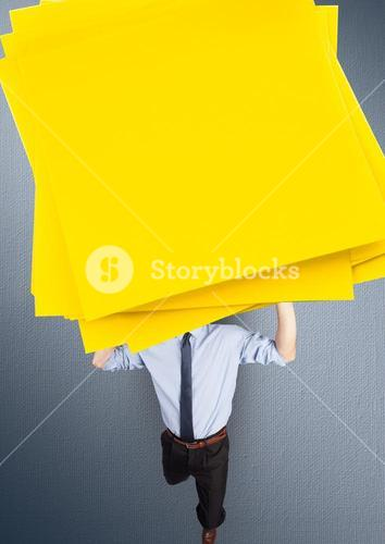 Digital composite image of a businessman carrying a stack sticky notes