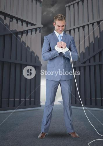 Digital composite image of businessman with hands tied up