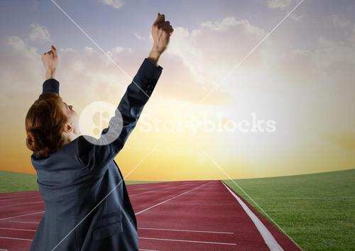 Digital composite image of a businesswoman winning the race