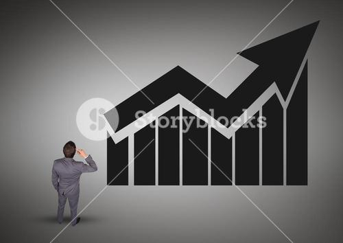 DIgital composite image of a businessman with graph chart