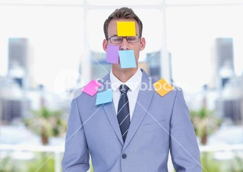 Sticky notes stuck on businessman
