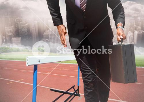 Businessman holding briefcase and running on race track