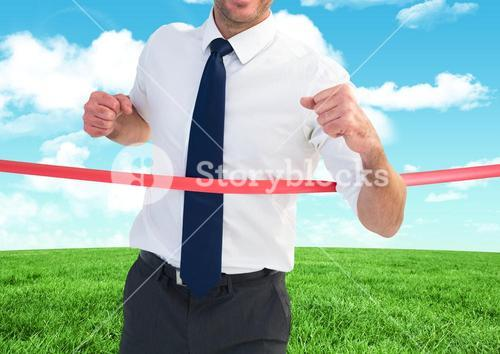 Businessman crossing finish line against sky and cloud