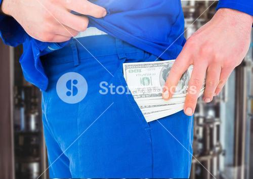 Male worker putting several dollar banknotes into his pocket