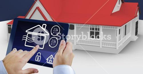 Hands using digital tablet with home security icons