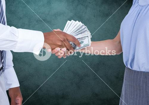 Businessman bribing partner while shaking hands against teal background