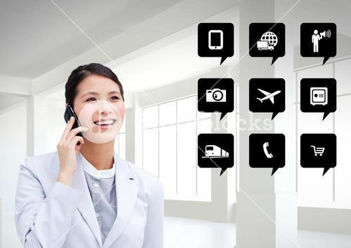 Businesswoman talking on mobile phone next to application icons