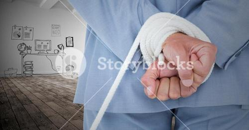 Businessman hands tied up with rope against graphic concept