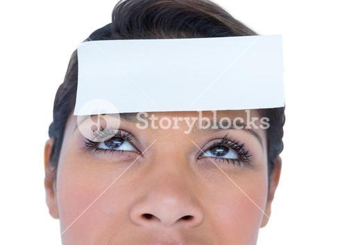 Blank paper note on a woman forehead