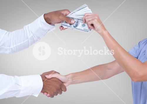 Businessman bribing partner while shaking hands against grey background