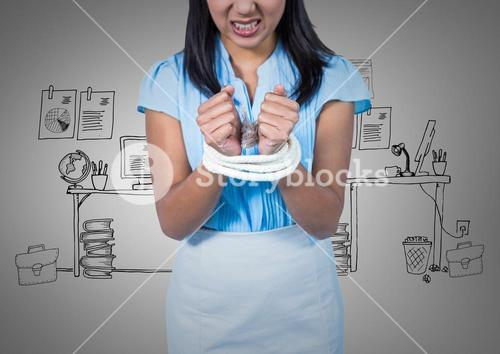 Businesswoman hands tied up in rope