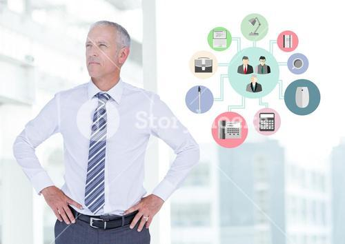 Businessman standing with hands on hips next to application icons