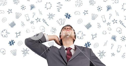 Businessman thinking over graphic signs above her head