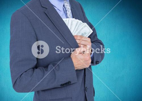 Businessman putting dollar banknotes into the chest pocket