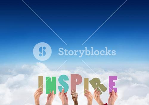 Hands holding word INSPIRE against blue sky and clouds