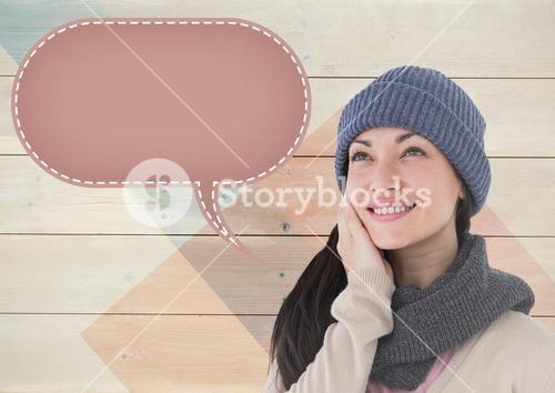 Smiling woman with blank speech bubble against wooden background