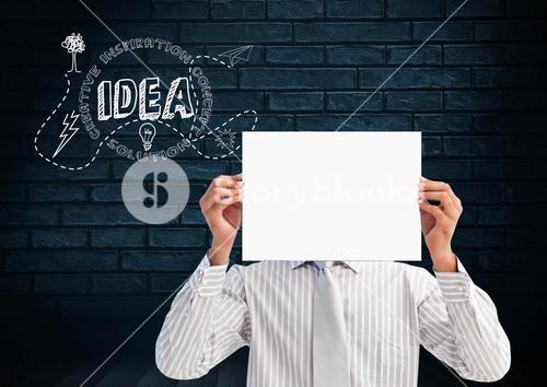 Businessman holding a blank placard in front of his face with text idea