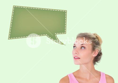 Thoughtful woman with blank tag against green background