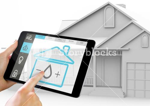 Hand holding digital tablet with home security icons on screen