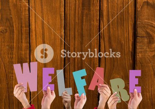 Hands holding word Welfare against wooden background