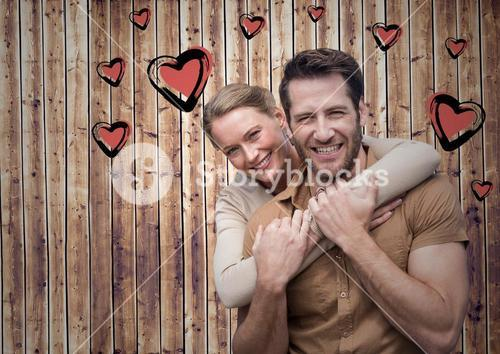 Romantic couple against wooden background