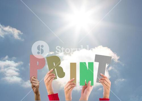 Hands holding word Print against bright sunlight