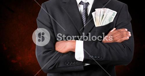 Corrupt businessman with money in pocket