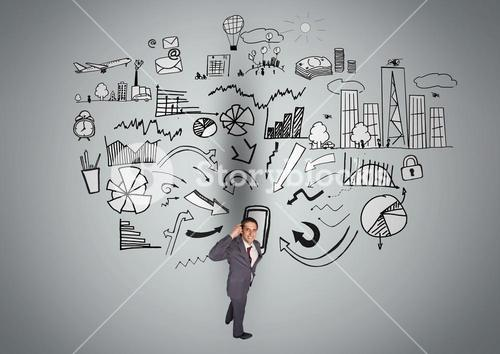 Thoughtful businessman with business symbols against grey background