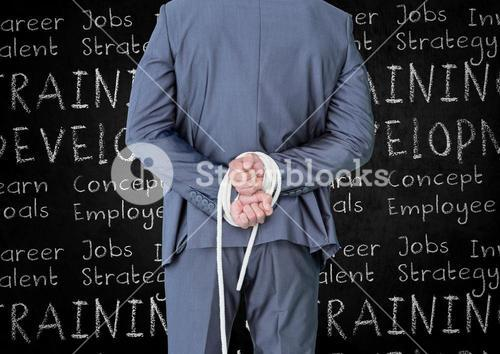 Rear view of businessman with his hands tied with rope