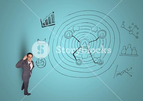 Thoughtful businessman with business doodles against blue background