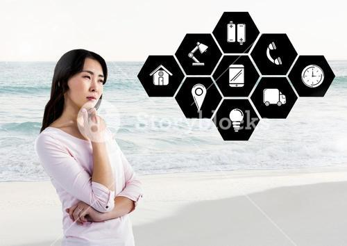 Thoughtful woman with application icons against beach in background