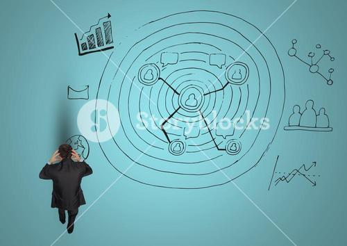 Stressed businessman with business doodles against blue background
