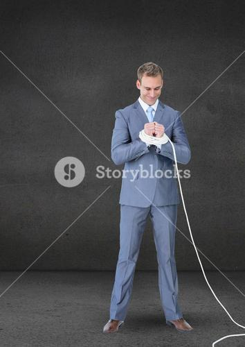 Businessman hands tied with a rope against grey background