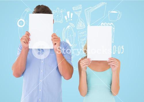 Couple holding blank page in front of their face against blue background