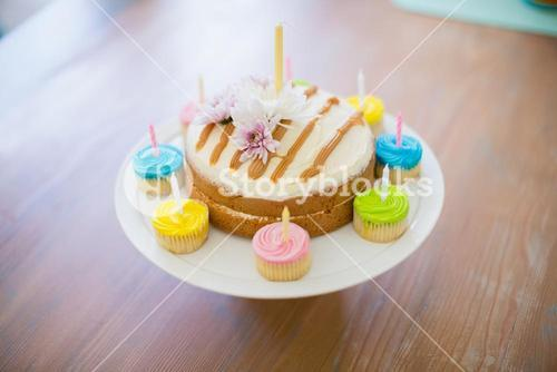 Close-up of a decorated birthday cake on a cake stand