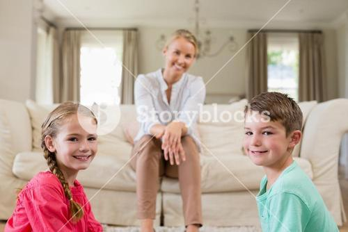 Mother and kids smiling in living room