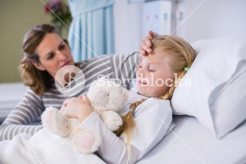 Mother comforting her daughter