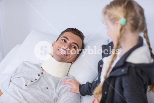 Smiling daughter comforting her sick father